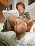 germannylonpics Nylonfeet and nylonfeetsoles under the table