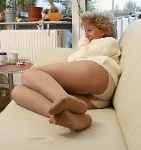 germannylonpics Mature woman in pantyhose show off her nylon feet soles