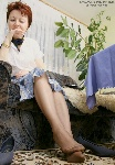 germannylonpics Mature woman show of her nyloned feet with reinforced toe